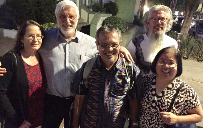 From left to right, Mary Roberts, Jeff Roberts, Jamartin Sihite, Richard Elliott, JoAnn Yee take a moment to snap a group photo during a night on the town in Davis.